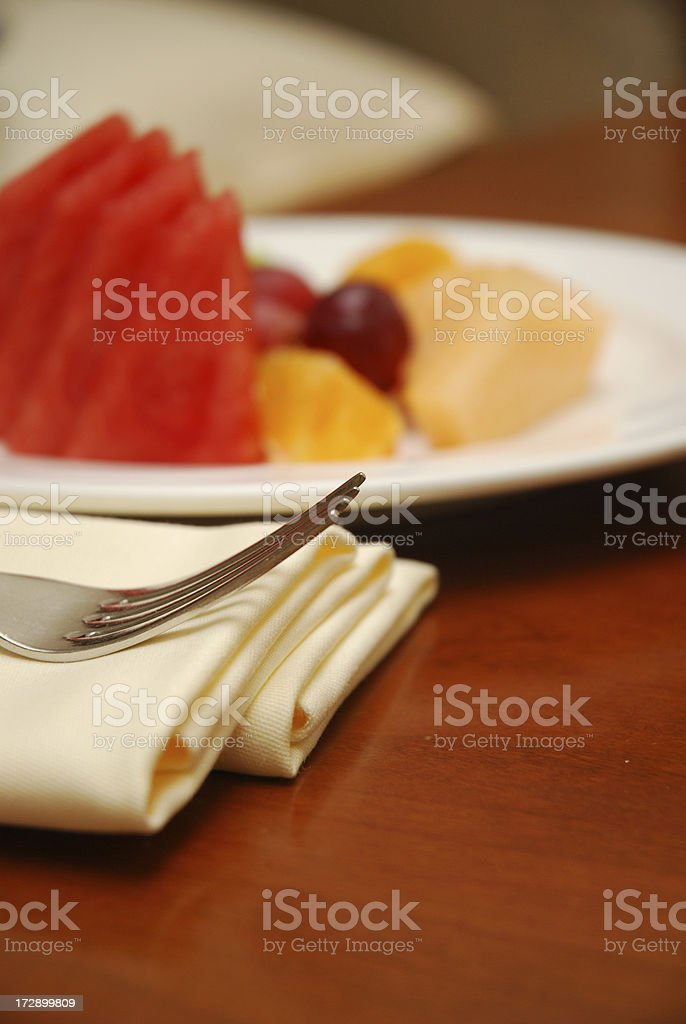 Fork and fruits royalty-free stock photo