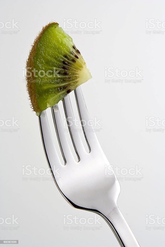 Fork and Kiwi Wedge royalty-free stock photo