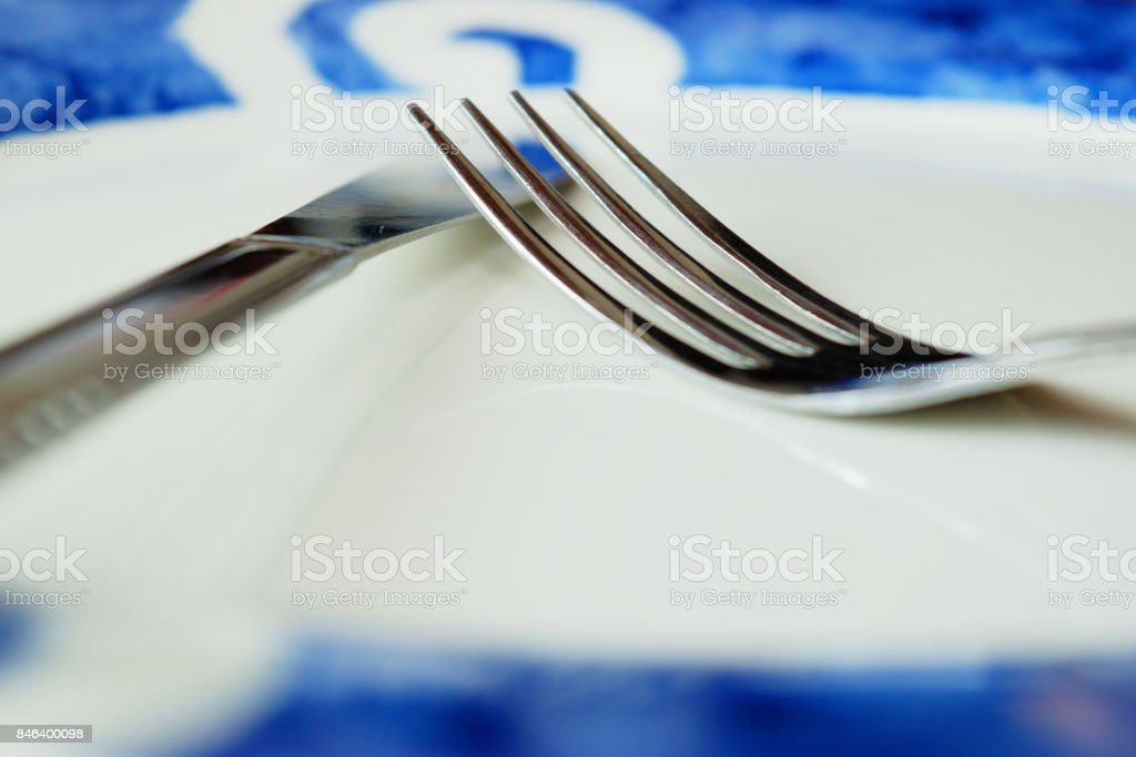 Fork and knife on plate stock photo