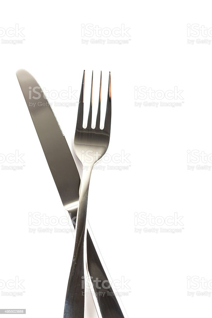 Fork and knife on white background,top view. stock photo