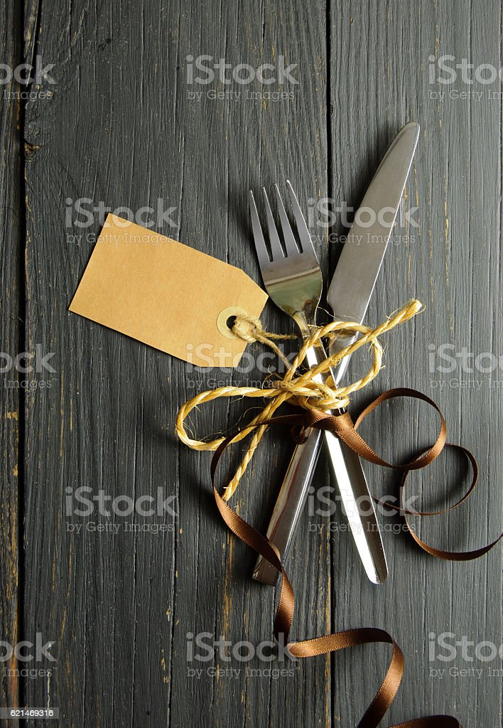 Fork and knife with label stock photo