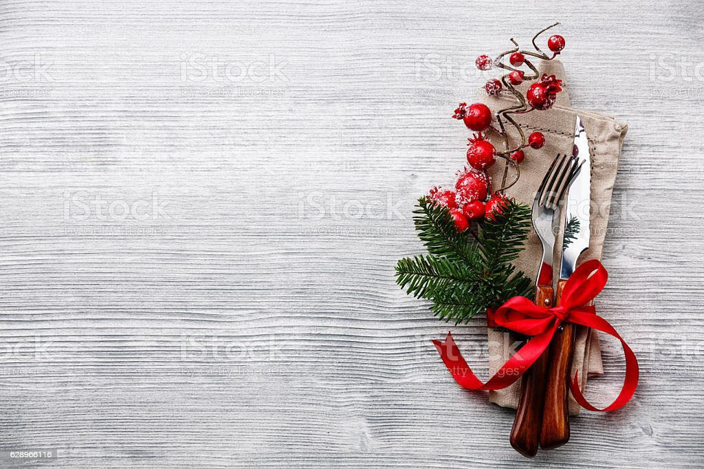 fork and knife with napkin and christmas fir branch stock photo