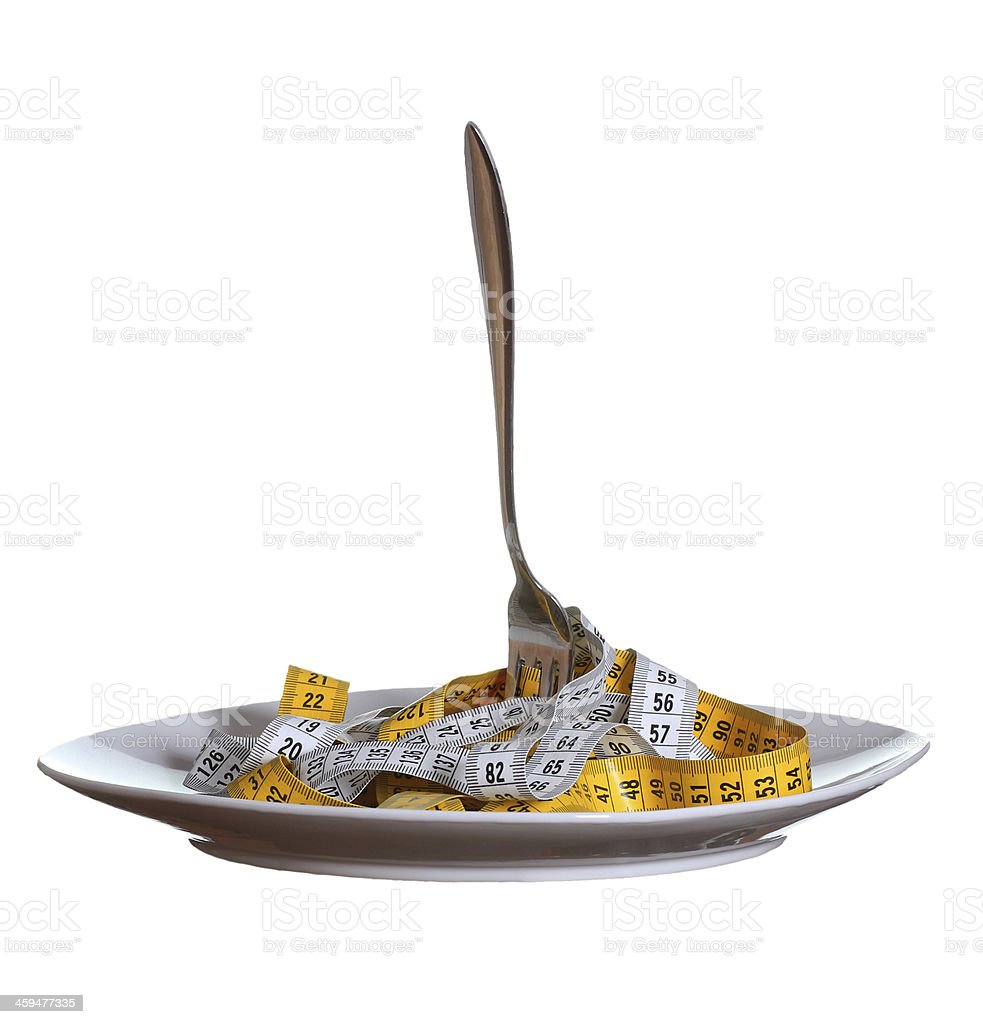 fork and measure tape on plate stock photo