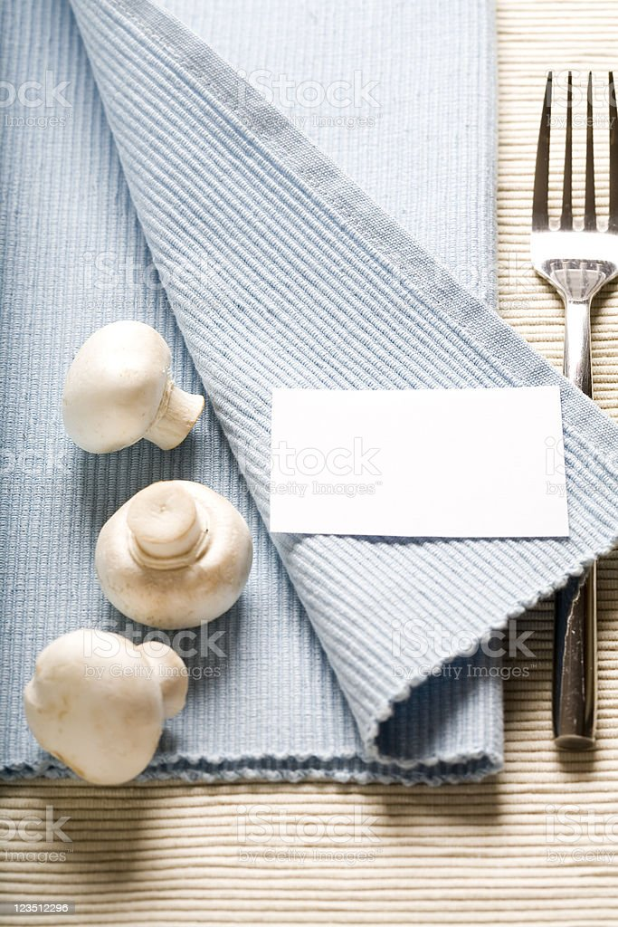 fork and mushrooms on blue napkin royalty-free stock photo