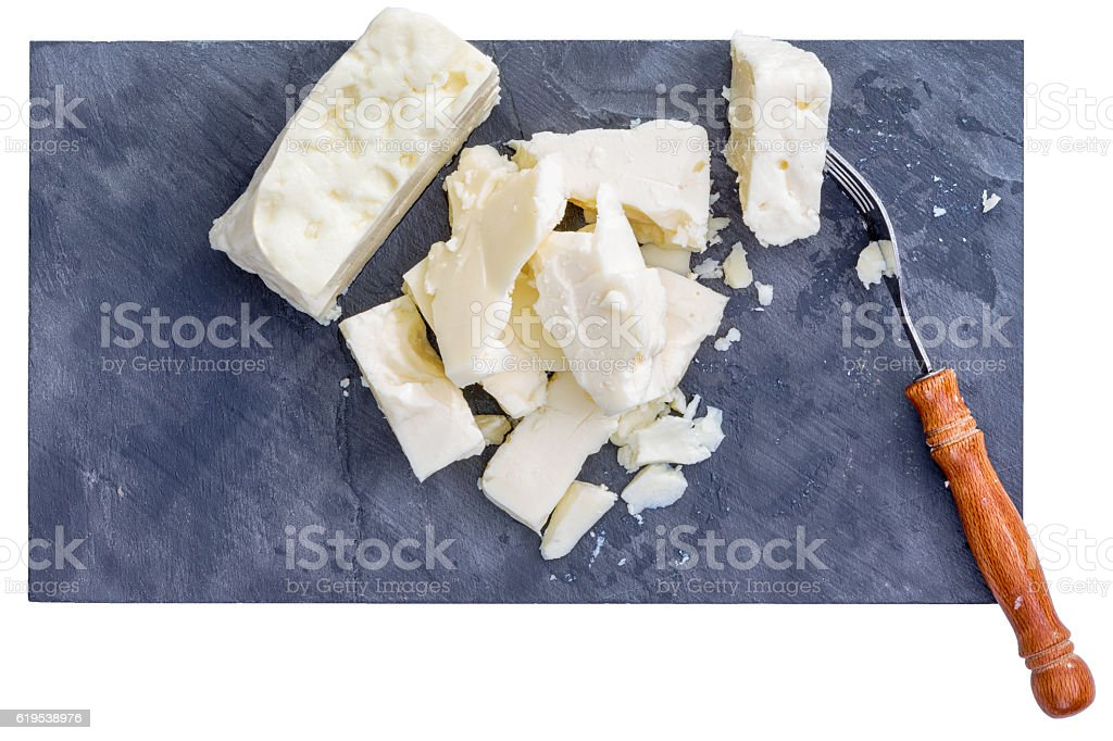 Fork and pieces of white feta cheese stock photo