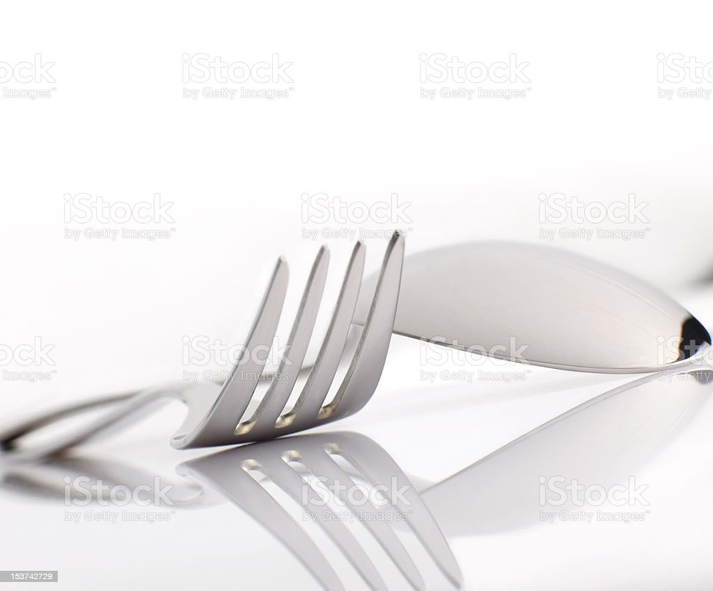 Fork and spoon on white background with space for text royalty-free stock photo