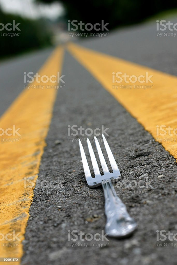 Fork in the road parallel to the yellow dividers royalty-free stock photo