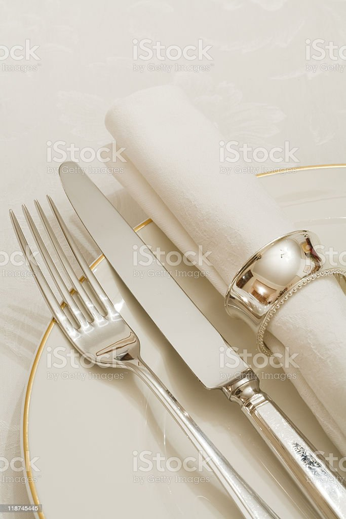 Fork, knife and napkin set on white plate  royalty-free stock photo