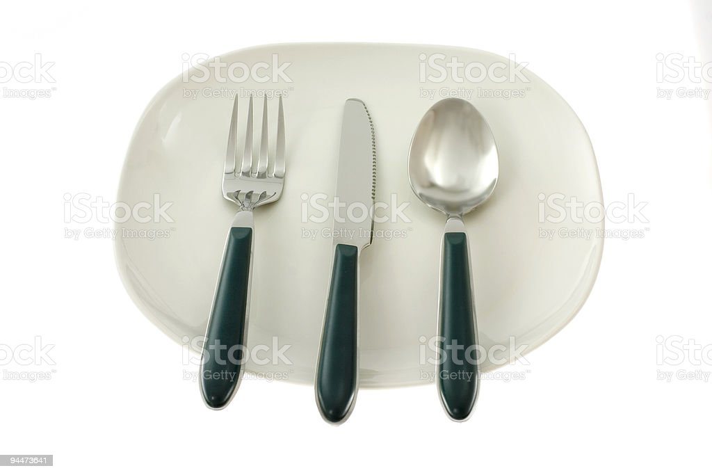 Fork, knife and spoon on a plate royalty-free stock photo