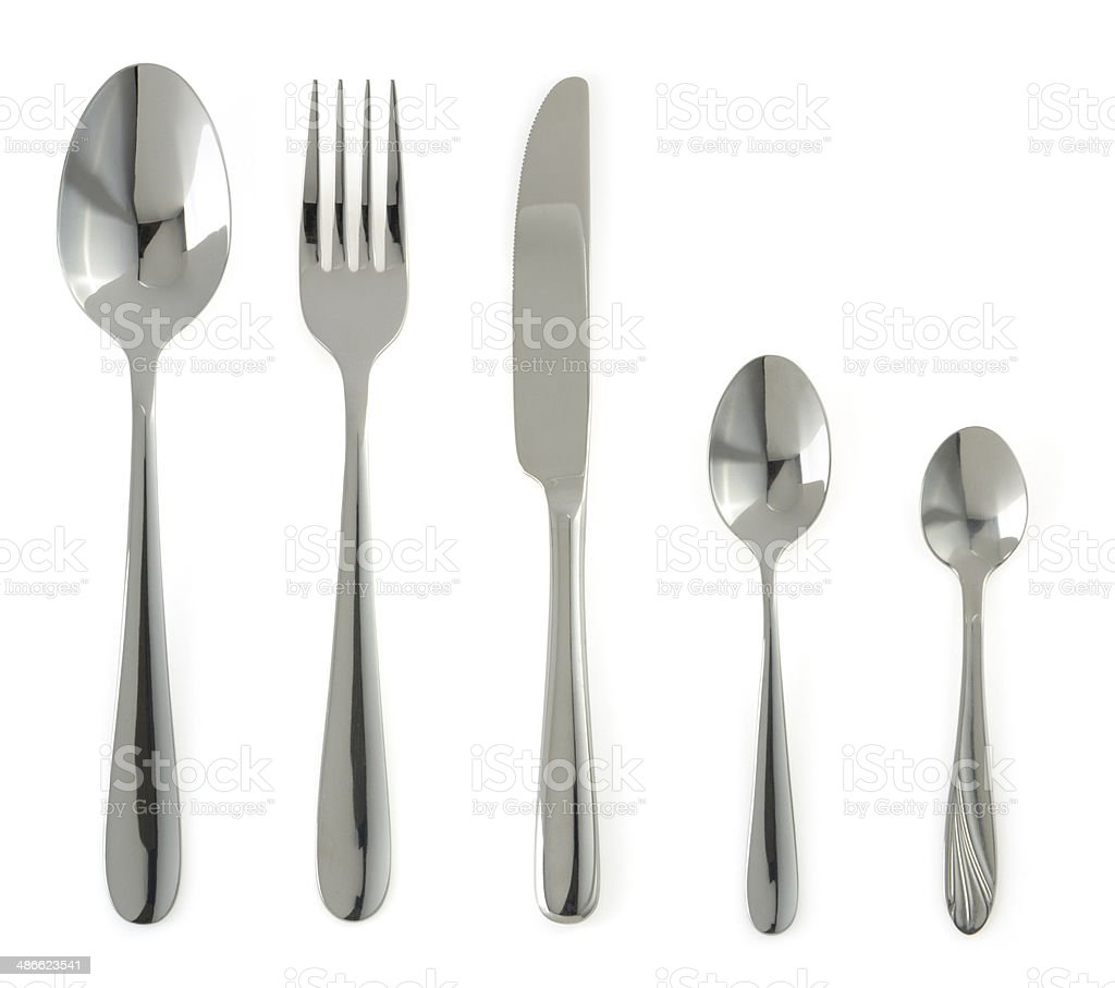 fork, knife and spoons on white stock photo