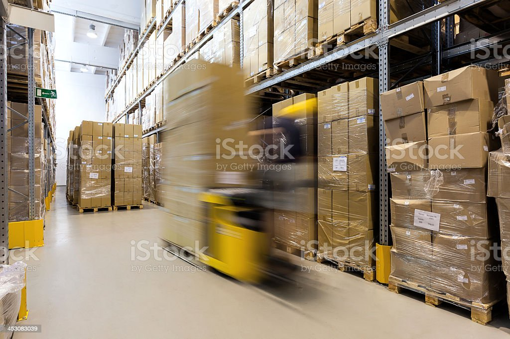 Fork lift operator with products stock photo