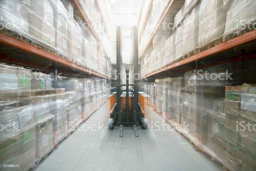 Fork lift truck in packing warehouse stock photo