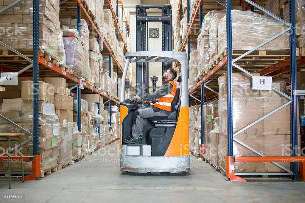 Fork lift truck in warehouse stock photo
