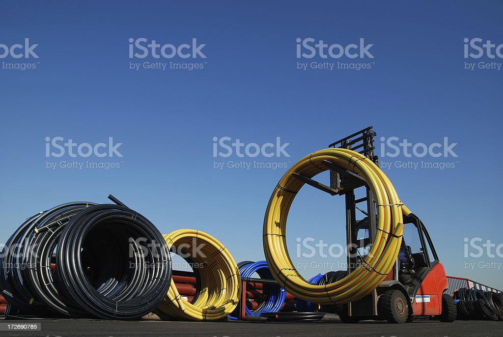 Fork lift with plastic tube royalty-free stock photo