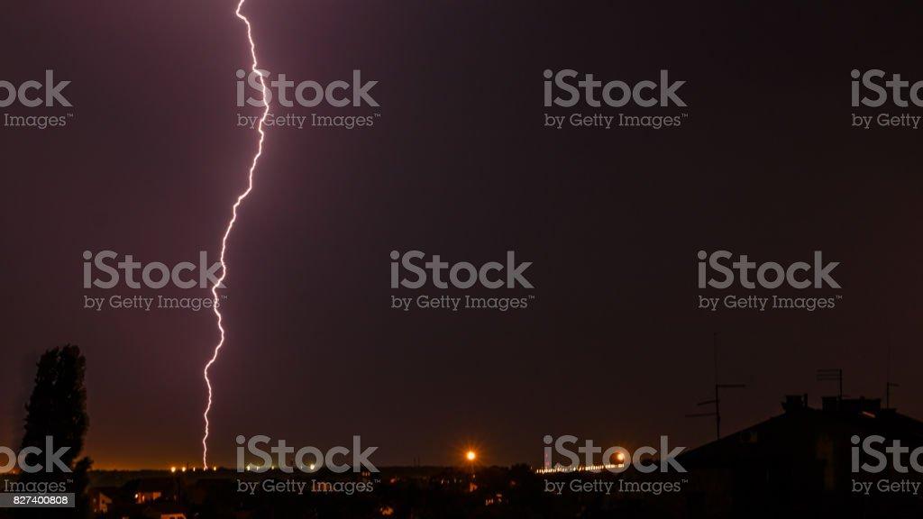 Fork lightning striking down during summer storm stock photo