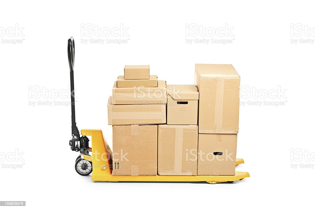 Fork pallet truck stacker with many boxes stock photo
