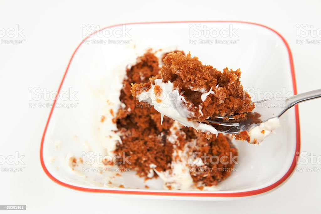 Fork Scooping up a Bite of Carrot Cake stock photo