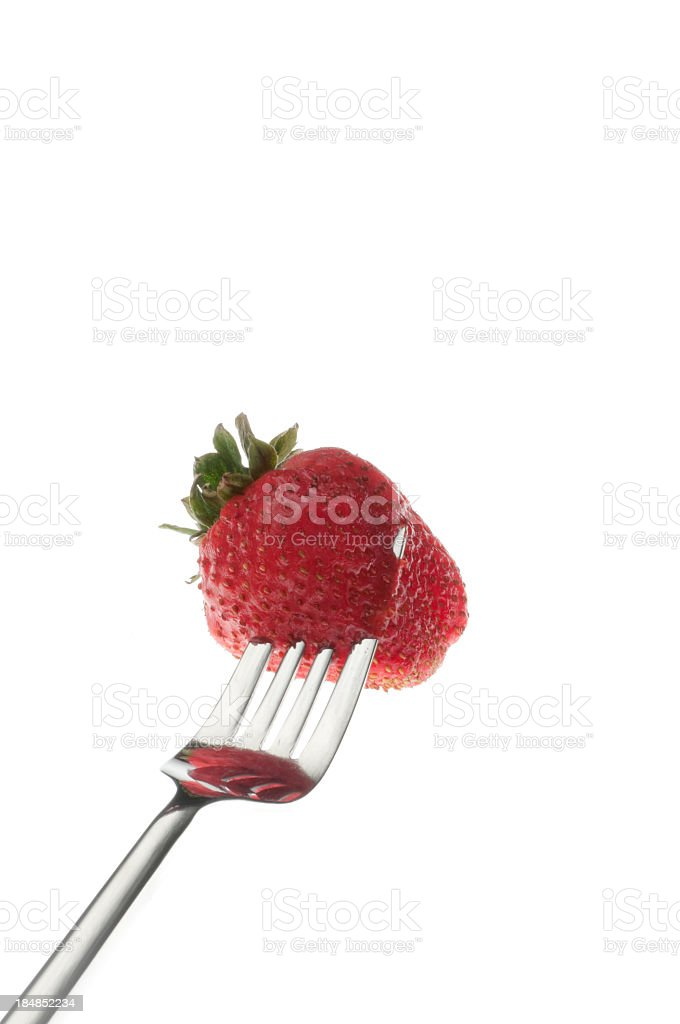 Fork spearing a strawberry royalty-free stock photo