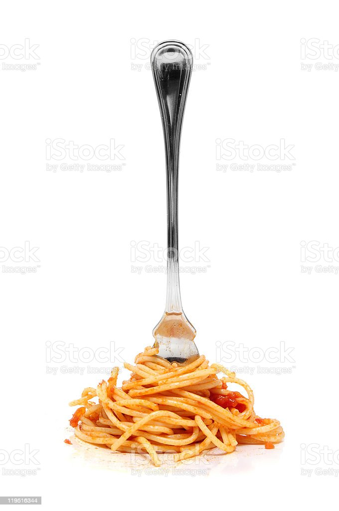 Fork stuck in a pile of spaghetti stock photo