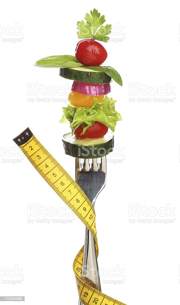 Fork with letucce and tomato over white royalty-free stock photo