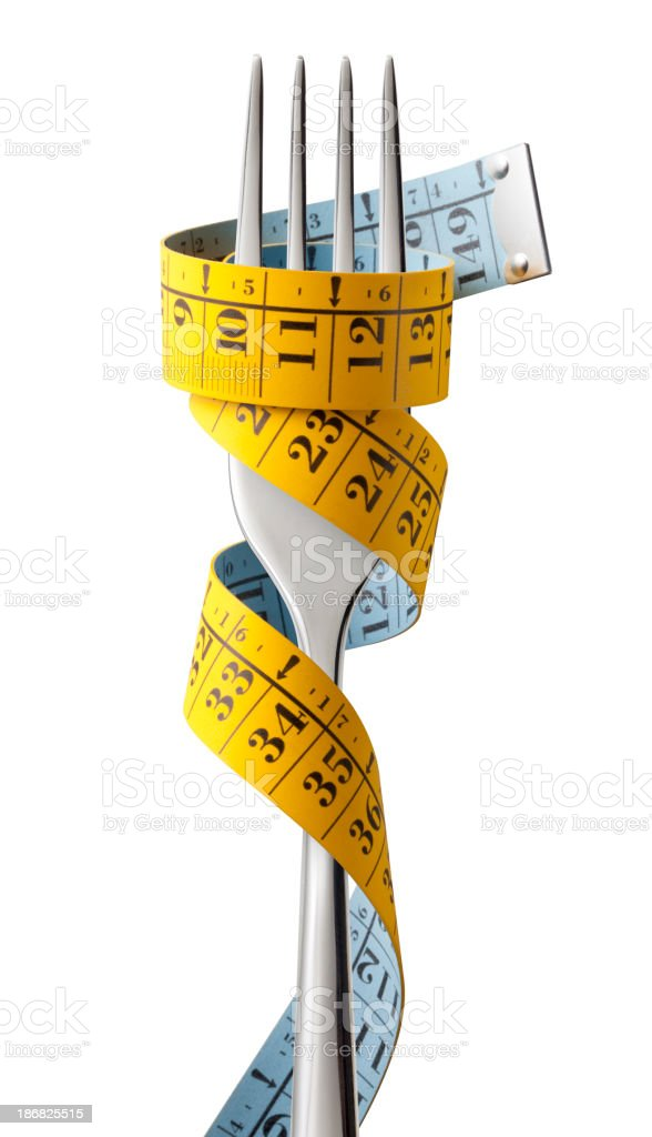 Fork with measuring tape royalty-free stock photo