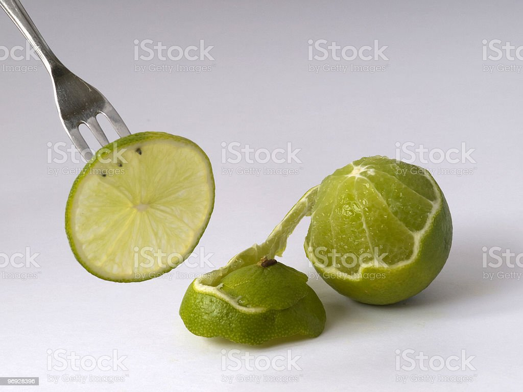 Fork with round and green lime. royalty-free stock photo