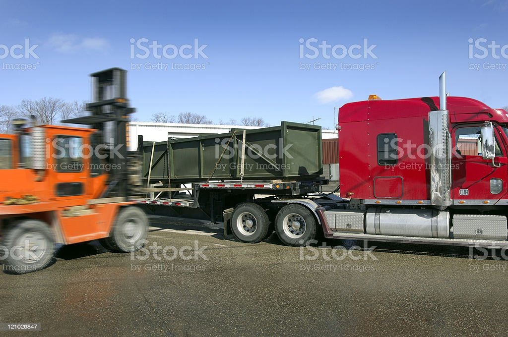 Forklift and transport truck royalty-free stock photo