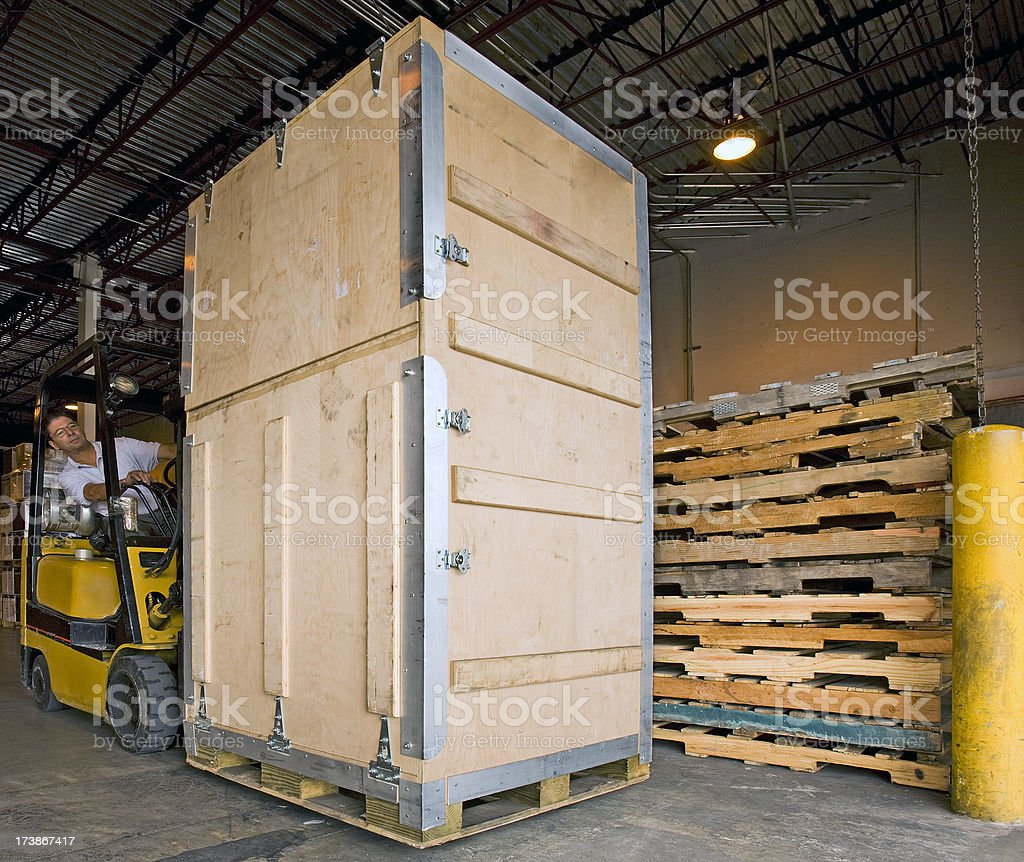 Forklift driver and freight picking heavy things royalty-free stock photo
