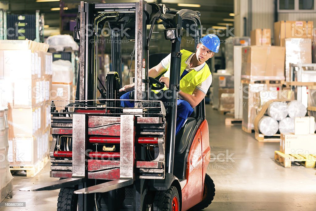 forklift driver at warehouse of forwarding stock photo