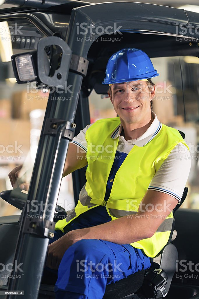 forklift driver at warehouse of forwarding royalty-free stock photo