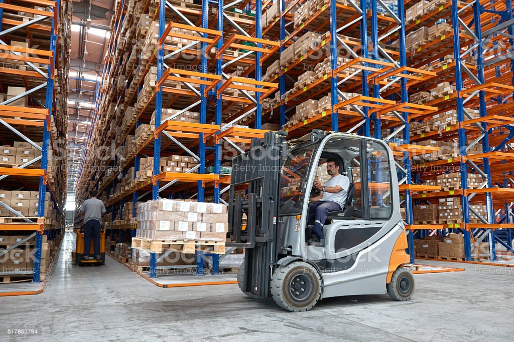 Forklift Driver In Warehouse stock photo