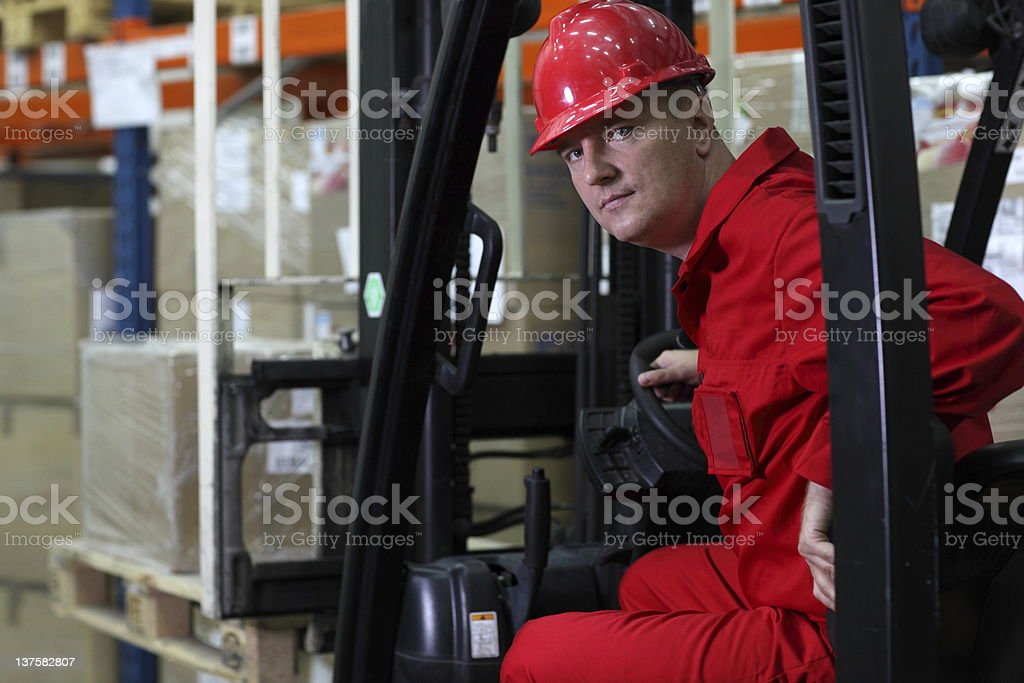 forklift driver worker in red uniform portrait royalty-free stock photo