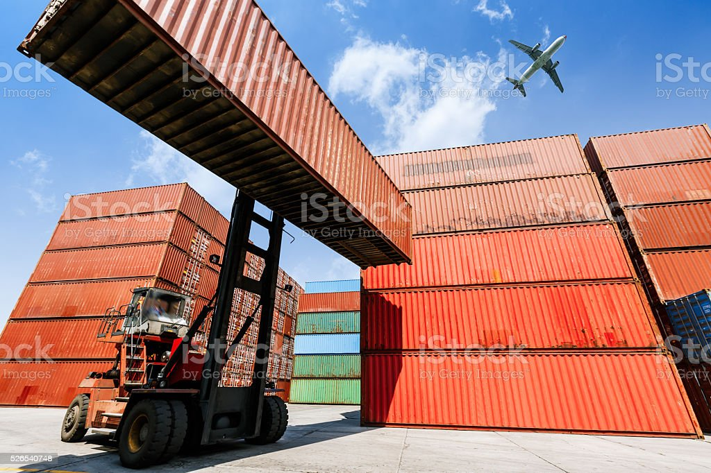 forklift handling container box loading for logistic stock photo