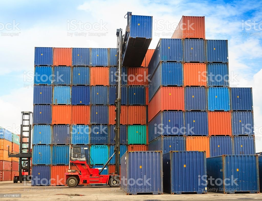 Forklift handling the container box royalty-free stock photo