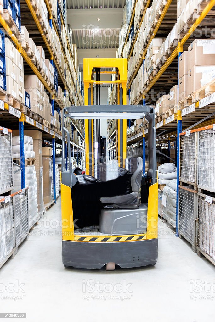 Forklift in corridor of large warehouse stock photo