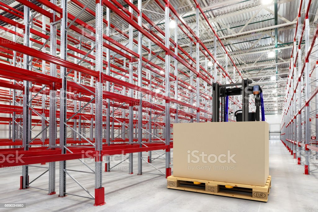 Forklift in empty warehouse stock photo