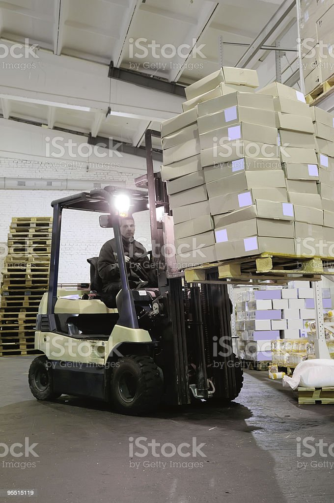 Forklift in warehouse royalty-free stock photo
