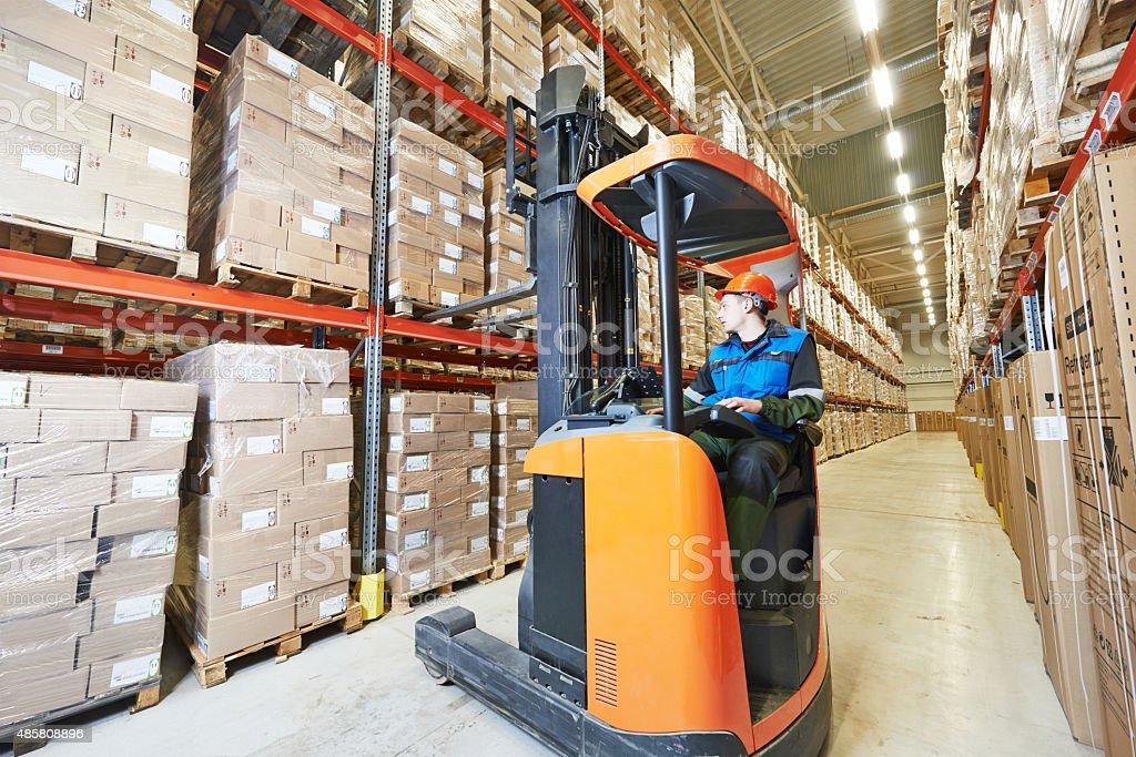 forklift loader at warehouse stock photo