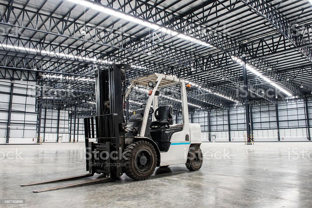 Forklift loader in large modern storehouse stock photo