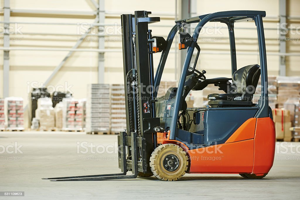 forklift loader stacker truck at warehouse stock photo