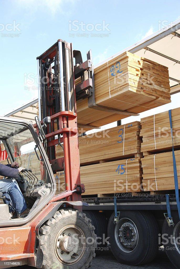 Forklift loading stacks of boards stock photo