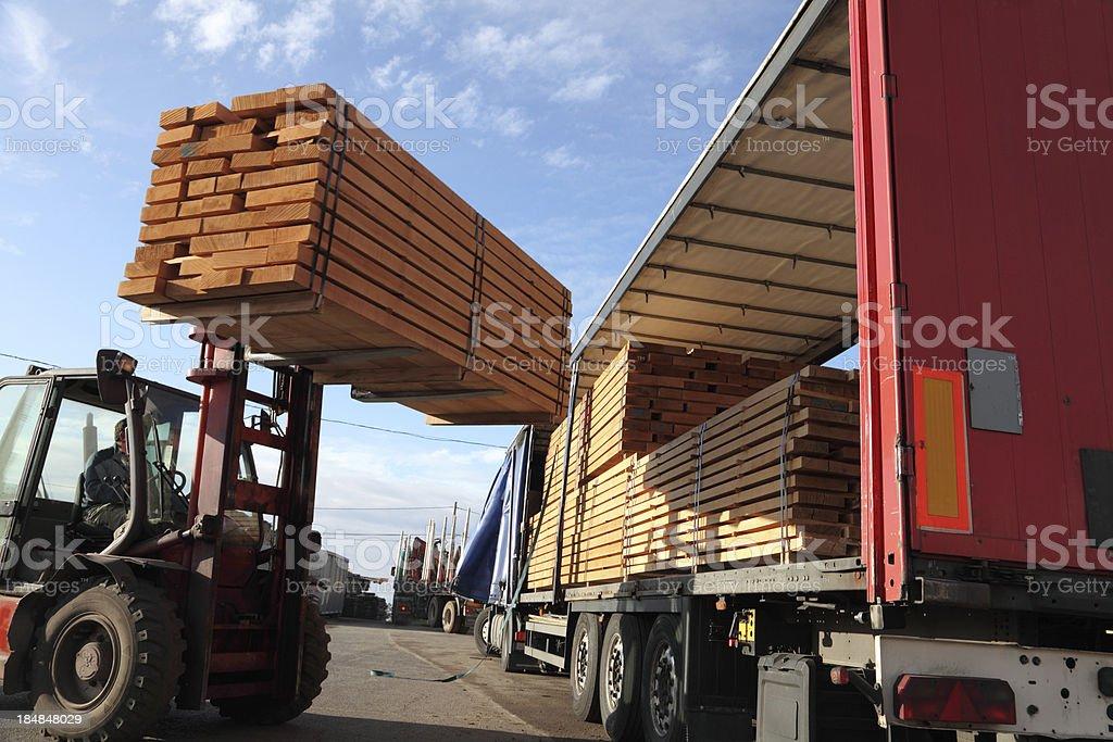 Forklift loading truck stock photo