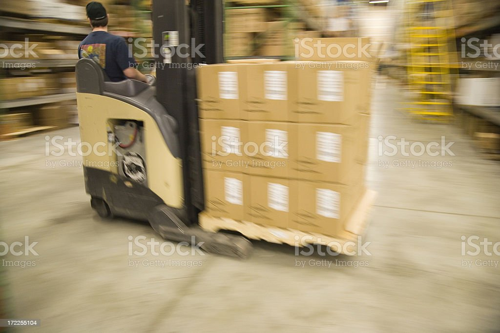 Forklift - moving boxes on a palette royalty-free stock photo