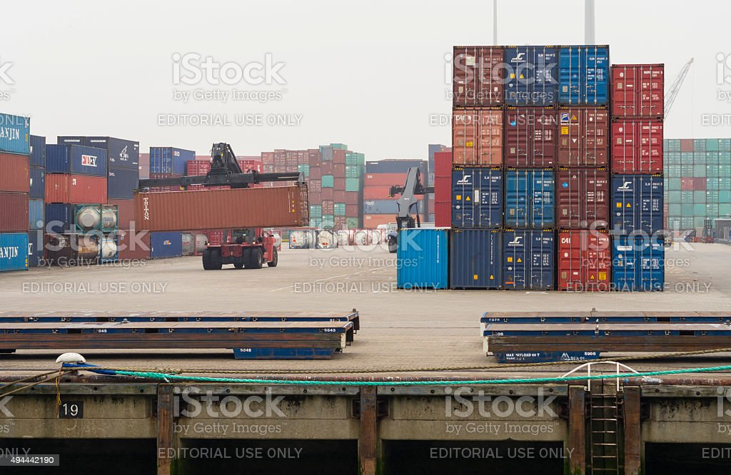 Forklift moving cargo containers at Rotterdam Europort container terminal stock photo