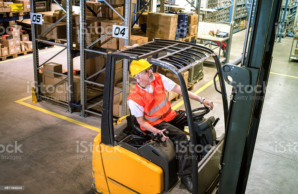 forklift operator at warehouse Loading, lifting stock photo