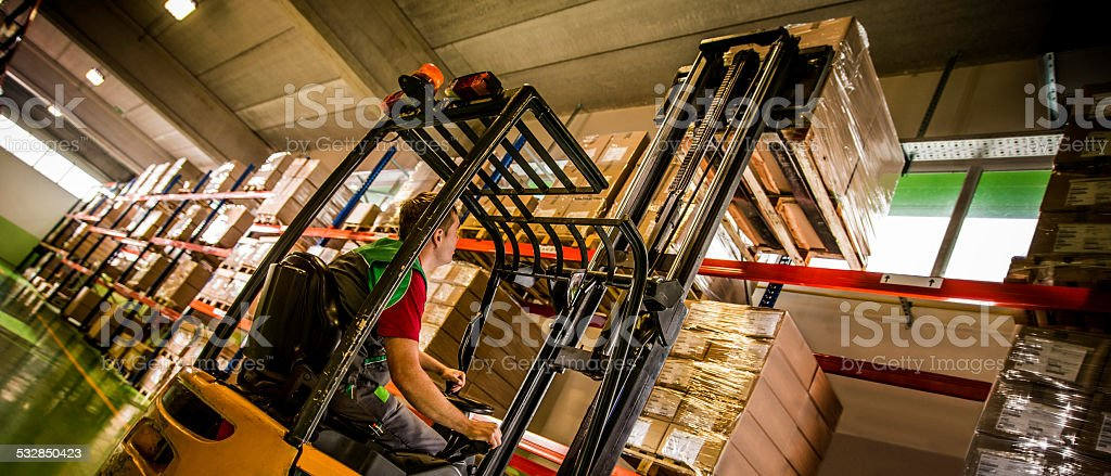 Forklift Operator Loading a Pallet stock photo