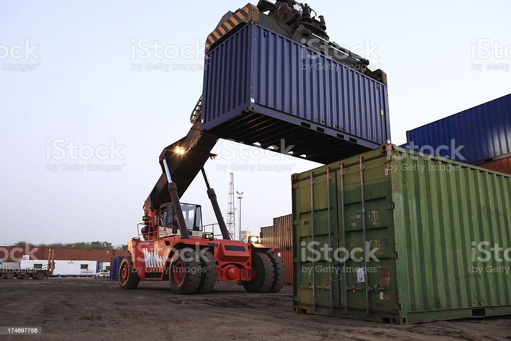 Forklift Stacking Cargo Containers in Dockyard royalty-free stock photo