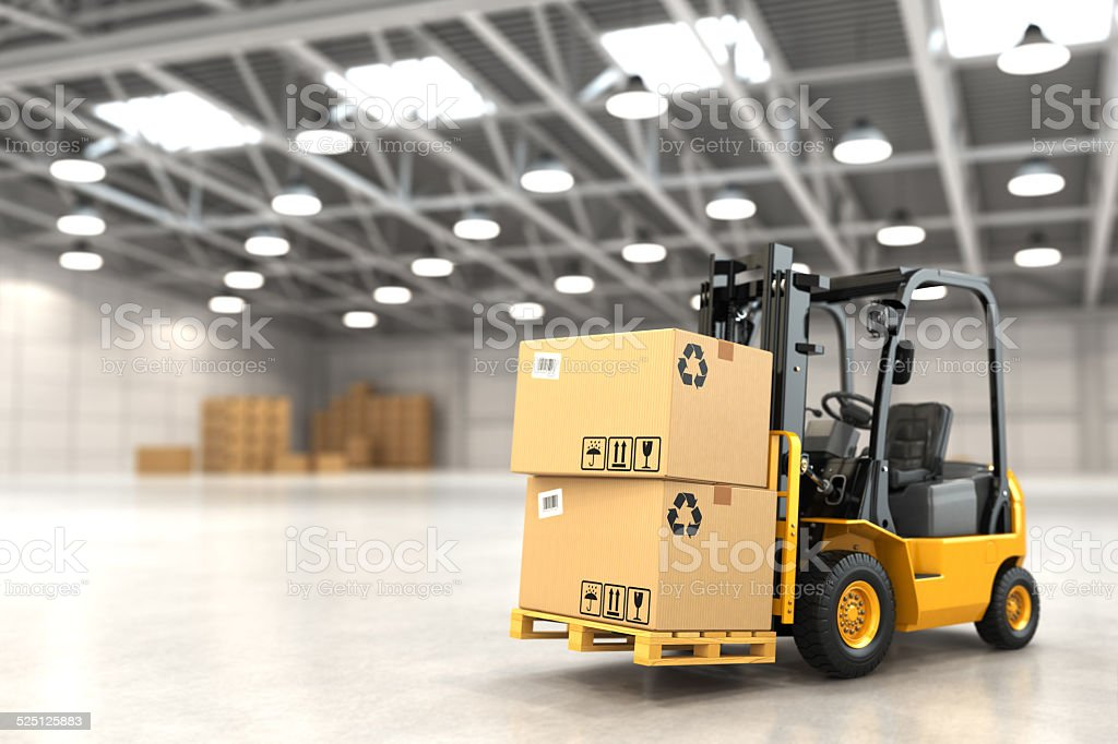 Forklift truck in warehouse or storage loading cardboard boxes. stock photo