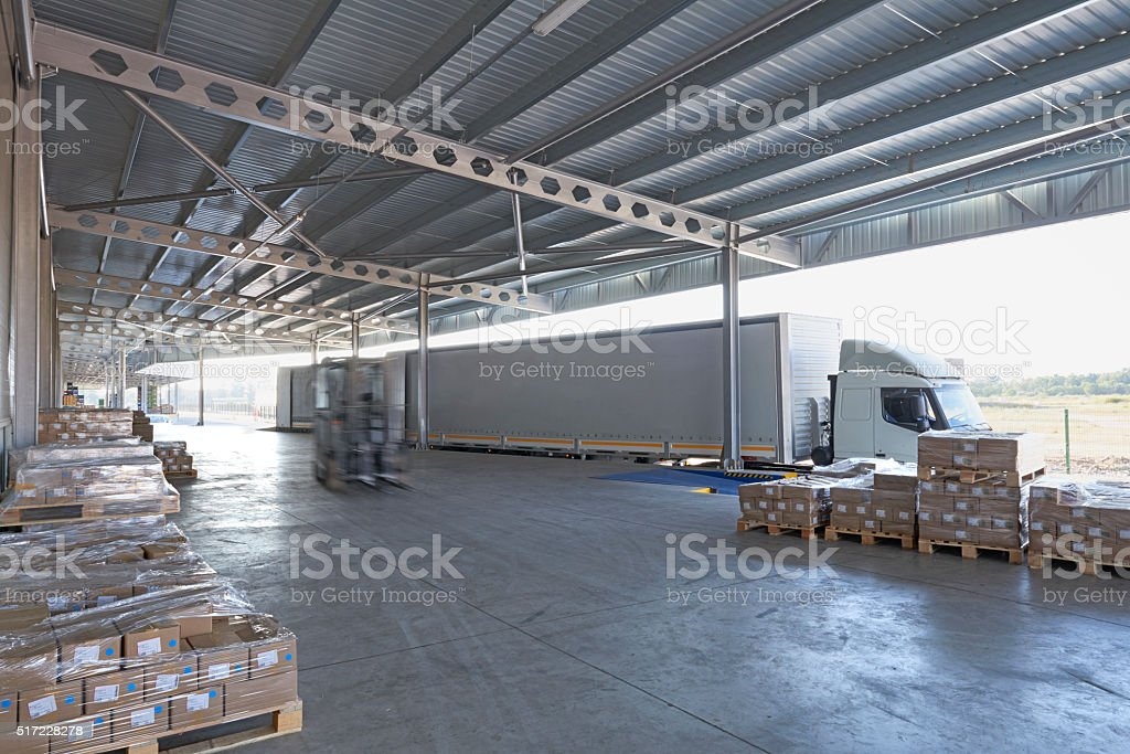 Forklift truck loading lorry stock photo