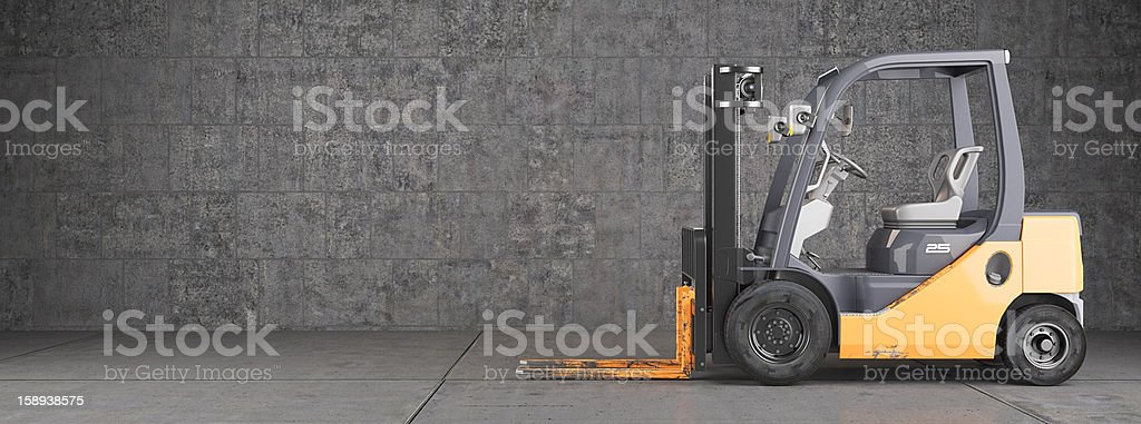 Forklift truck standing on industrial concrete wall background stock photo